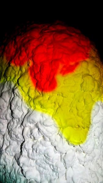Jemimah Dodd, 'Dollop', July 2014, Constance ARI. Video Installation, 4 min loop: icing sugar, food colouring. Installation: Styrofoam, plaster, chicken wire, expando-foam. 130 x 130 x 180